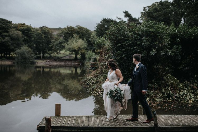 Bride and groom portrait on the dock for wedding with multiway bridesmaid dresses
