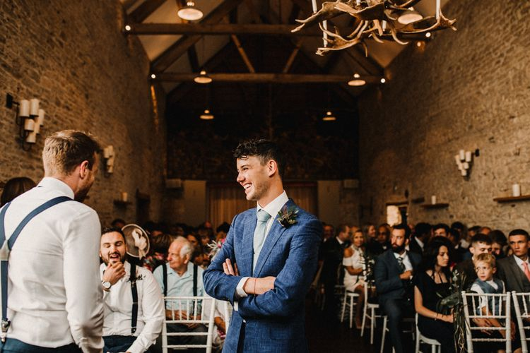 Groom In Cad And The Dandy Suit // Bride In The Row For Bohemian Wedding In The Cotswolds With PapaKata Tipi And Ceremony At Merriscourt With Images From Carla Blain Photography
