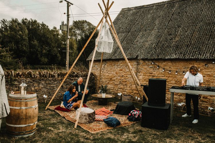 Boho Seating Area For Wedding // Bride In The Row For Bohemian Wedding In The Cotswolds With PapaKata Tipi And Ceremony At Merriscourt With Images From Carla Blain Photography