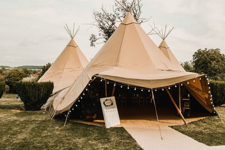 PapaKata Tipi For Wedding // Bride In The Row For Bohemian Wedding In The Cotswolds With PapaKata Tipi And Ceremony At Merriscourt With Images From Carla Blain Photography