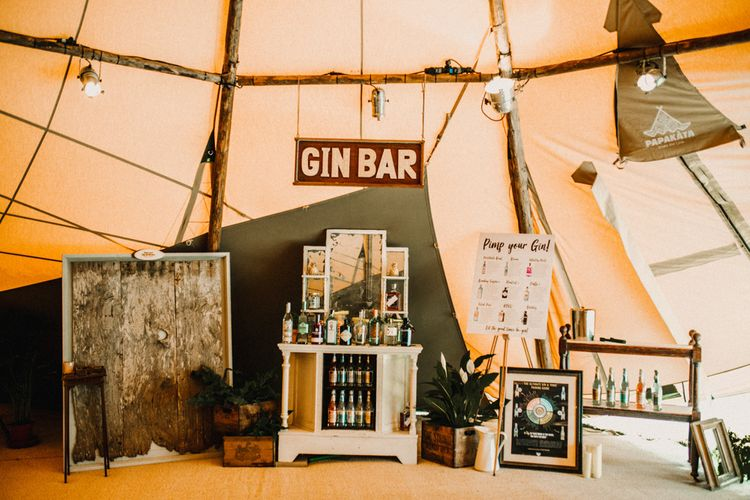 Gin Bar At Wedding // Bride In The Row For Bohemian Wedding In The Cotswolds With PapaKata Tipi And Ceremony At Merriscourt With Images From Carla Blain Photography
