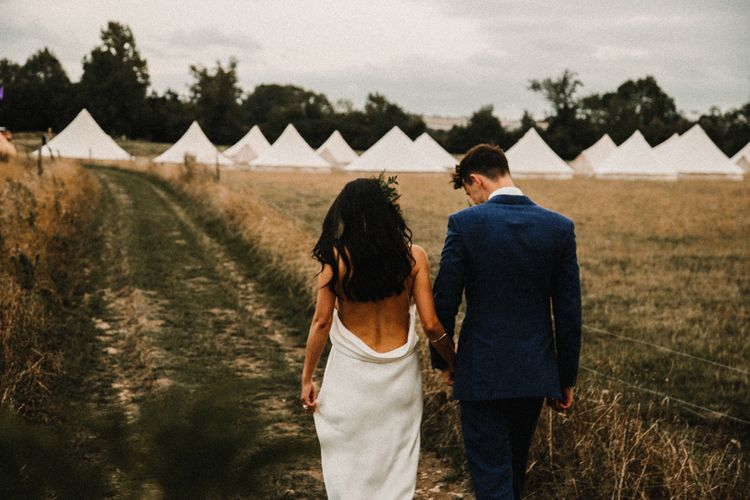 Bell Tent Camping For Wedding // Bride In The Row For Bohemian Wedding In The Cotswolds With PapaKata Tipi And Ceremony At Merriscourt With Images From Carla Blain Photography