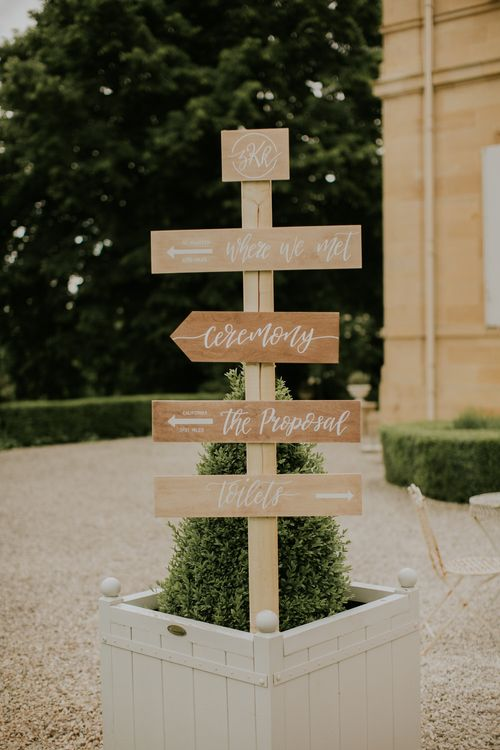Hand painted wooden wedding signage | Bespoke Planning and Styling by Helaina Storey Wedding Design | Image by Aubree Lynn Photography
