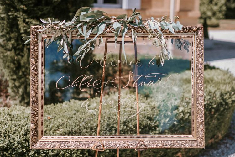 Calligraphy on mirror with antique frame | Bespoke Planning and Styling by Helaina Storey Wedding Design | Image by Alice Cunliffe Photography