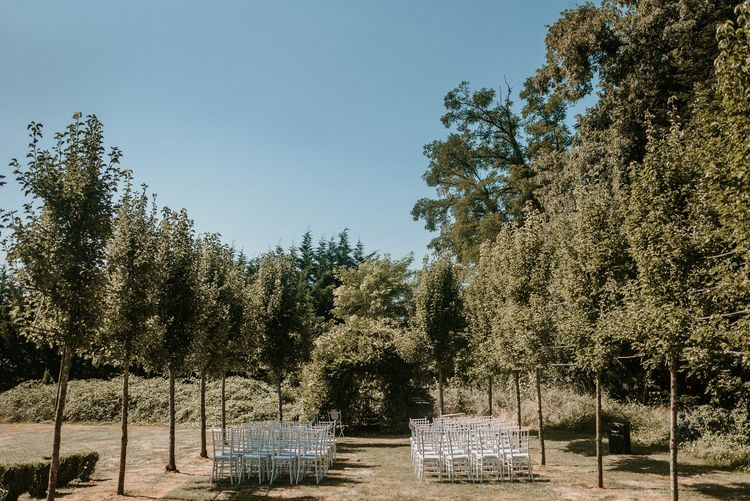 Outdoor tree lined aisle | Bespoke Planning and Styling by Helaina Storey Wedding Design | Image by Alice Cunliffe Photography