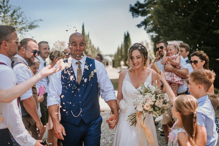 Outdoor wedding confetti shot | Bespoke Planning and Styling by Helaina Storey Wedding Design | Image by Alice Cunliffe Photography
