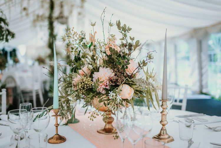 Earthy toned florals with coloured tapered candles | Bespoke Planning and Styling by Helaina Storey Wedding Design | Image by Alice Cunliffe Photography