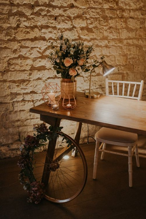 Register table with rustic wedding decor and candles at Lapstone Barn