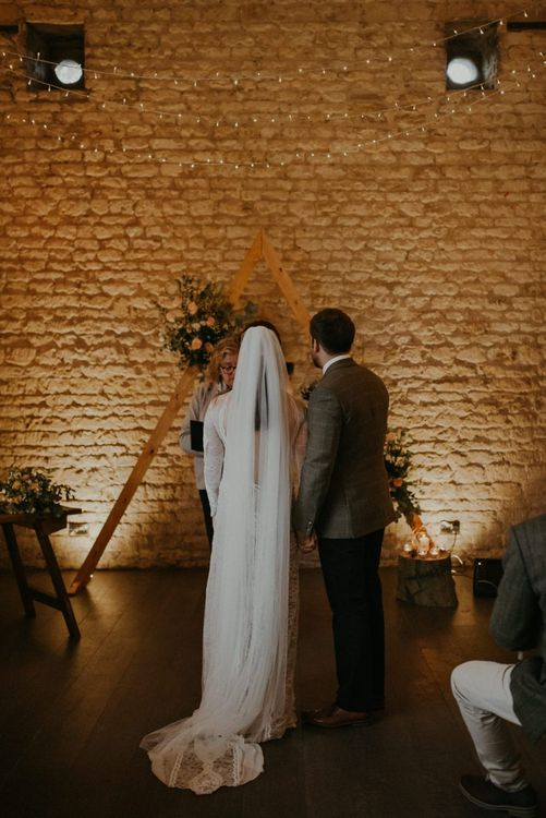 Bride and groom standing at the altar at Lapstone Barn