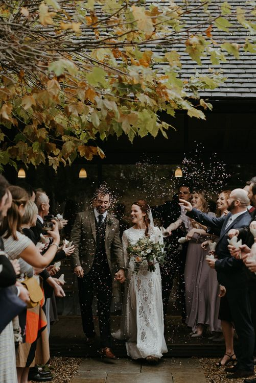 Confetti moment at Lapstone Barn with bride in Inca Grace Loves Lace dress