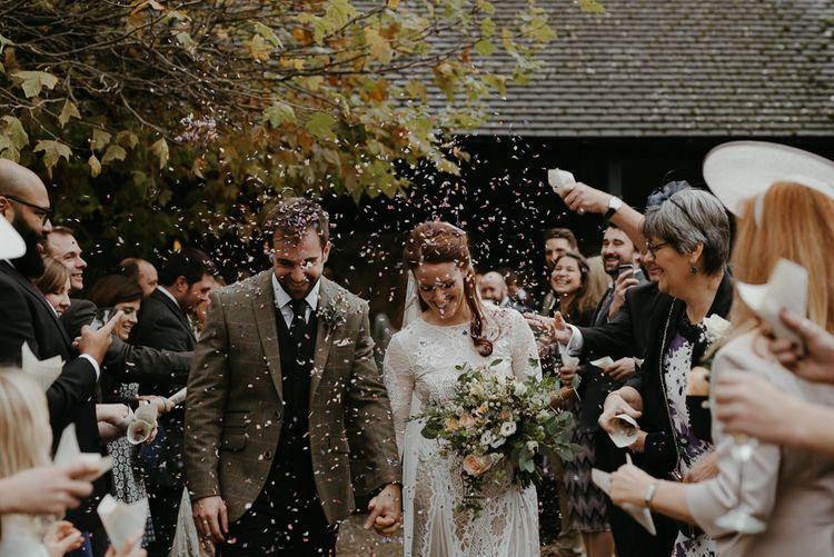 Winter wedding confetti exit