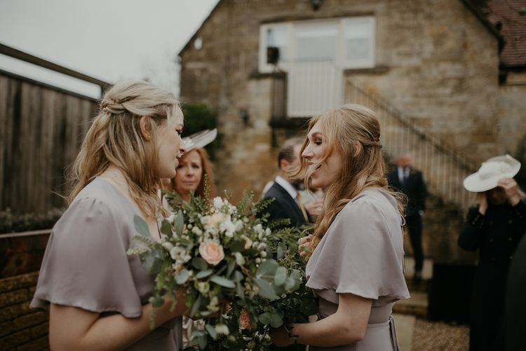 Bridesmaids in ReWritten Florence dresses in concrete shade