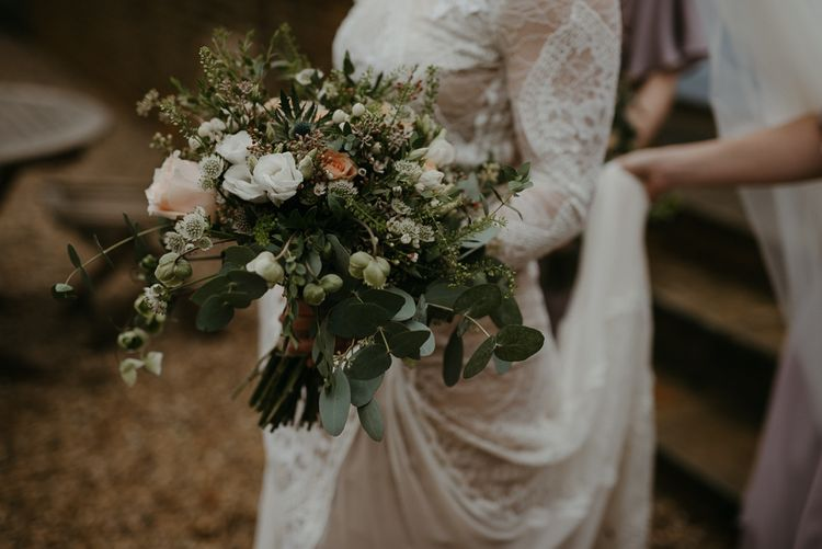 Green, white and peach wedding bouquet for winter wedding