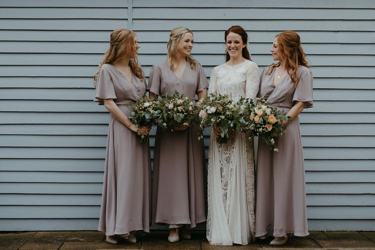 Bridal party portrait with bridesmaids in ReWritten dresses