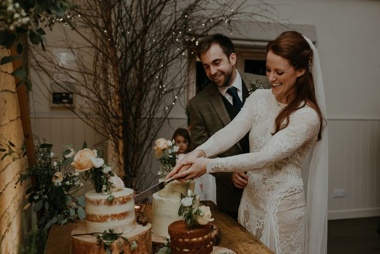 Bride and groom cutting the wedding cake at Lapstone Barn