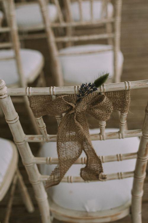 Burlap / Hessian Bow Chair Back Decor | Rustic Barn & Tipi Wedding at High House Farm Brewery, Northumberland | Maureen du Preez Photography