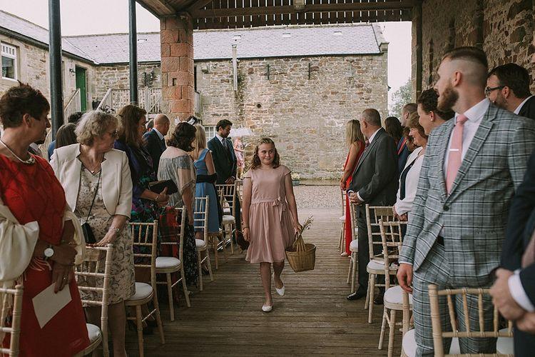 Wedding Ceremony | Pink Flower Girl Entrance | Rustic Barn & Tipi Wedding at High House Farm Brewery, Northumberland | Maureen du Preez Photography
