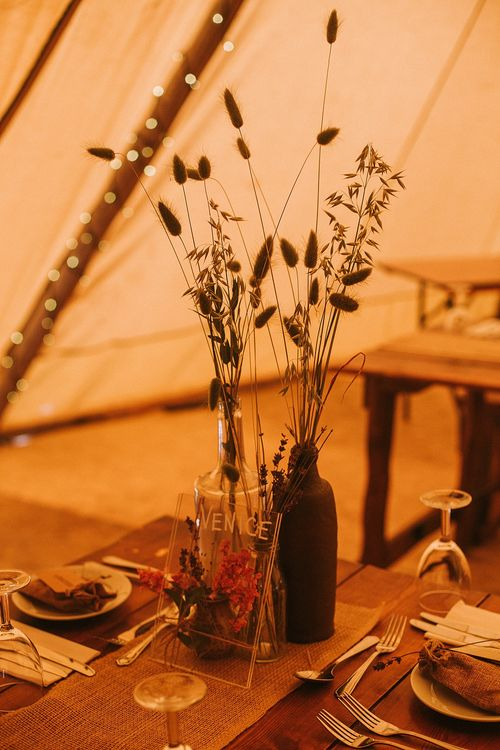Dried Flowers in Bottles | Wedding Decor | Rustic Barn & Tipi Wedding at High House Farm Brewery, Northumberland | Maureen du Preez Photography
