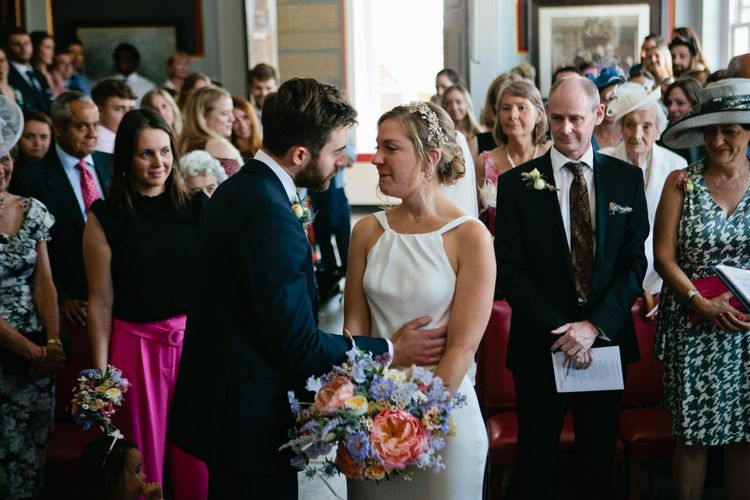 Bride in Halterneck Charlie Brear wedding Dress with Colourful Bouquet