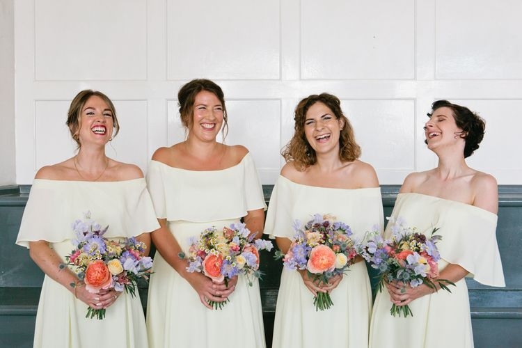 White Off The Shoulder Bridesmaid Dresses and Bright Bouquets