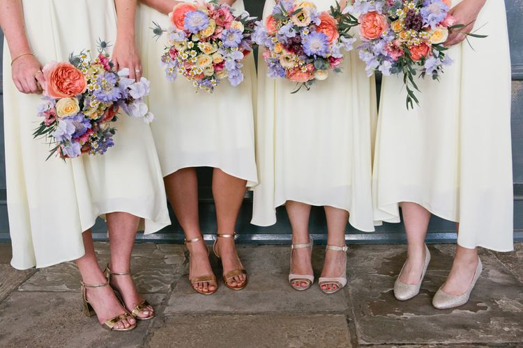 Bridesmaids in Different Gold Shoes