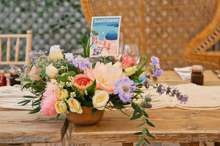 Colourful Wildflower Wedding Centrepiece with Postcard Table Name