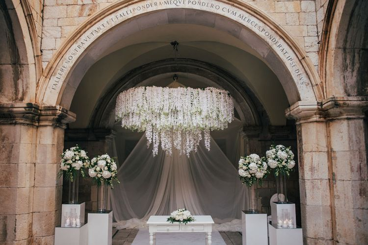Wedding Ceremony Altar Flowers with White Floral Chandelier and Tall Floral Arrangements
