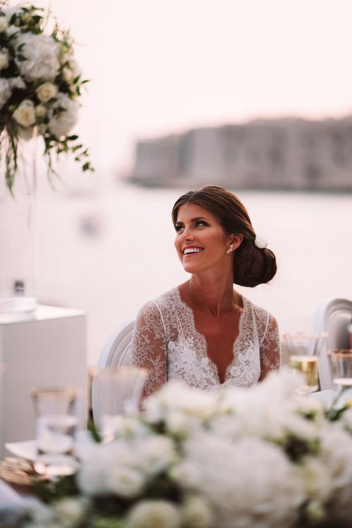 Beautiful Bride Smiling During Wedding Speeches