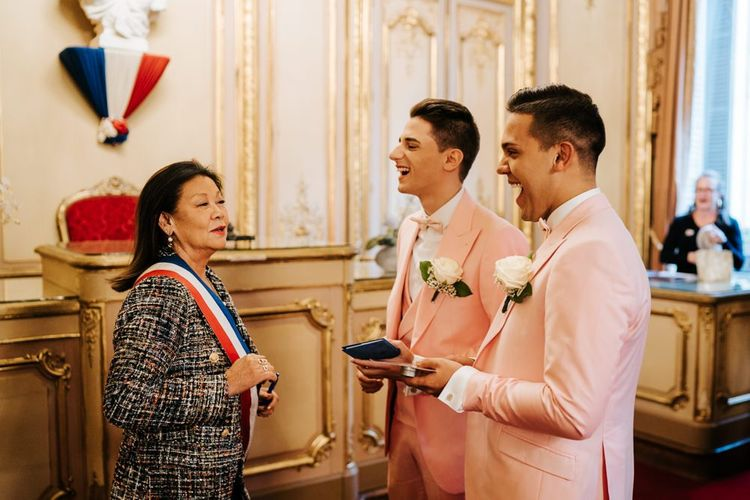 Grooms receiving official certificate at intimate Paris  ceremony in the city hall