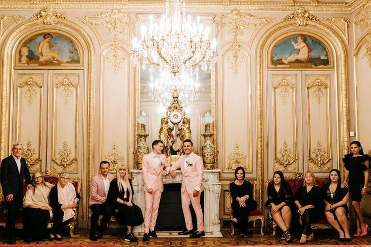 Family photograph in grand ceremony room in Paris with golden and ornate styling