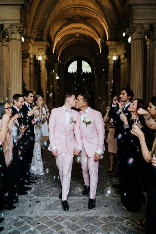 Bubble confetti moment with small champagne bottles at city hall same-sex ceremony in Paris