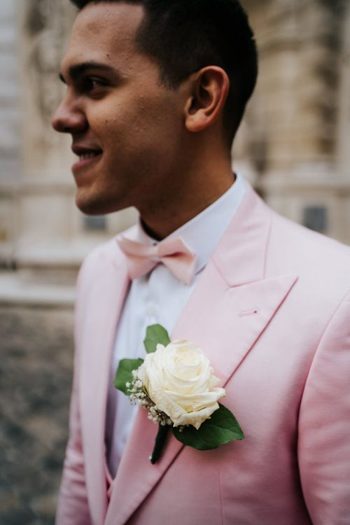 Pink bow tie and white rose buttonhole for same-sex celebration in Paris
