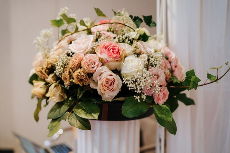 Pink and white rose floral arrangement at intimate Paris celebration