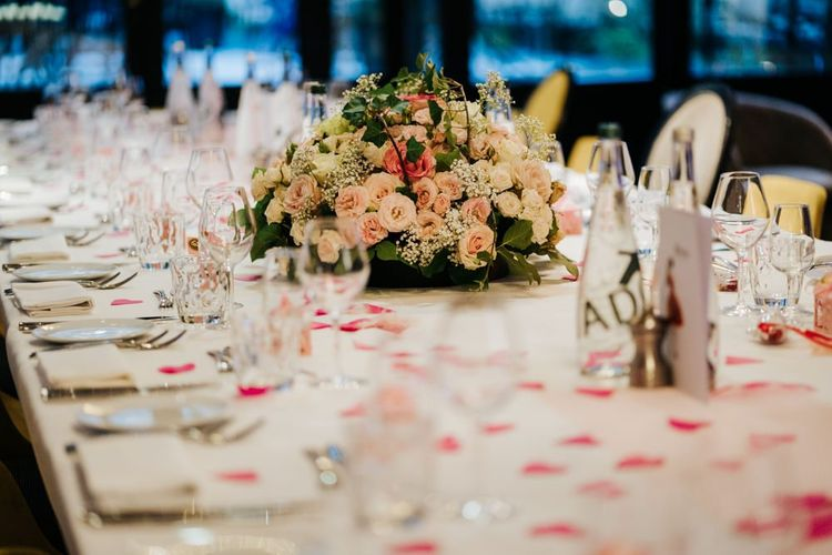 Table setting decor with white and pink rose floral arrangement at intimate Paris reception