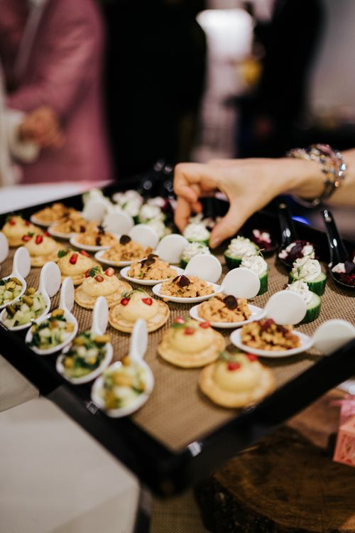 Food at intimate Paris celebration with pink and white styling and decor