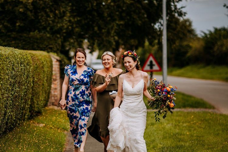 Bride in Lace Sottero & Midgley Wedding Dress Walking Down the Lane with Her Bridesmaids