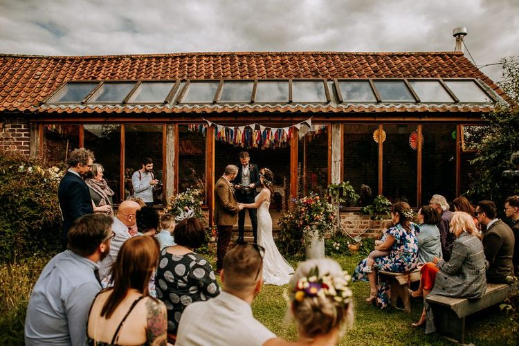 At Home Wedding Ceremony with Homemade Floral Bunting