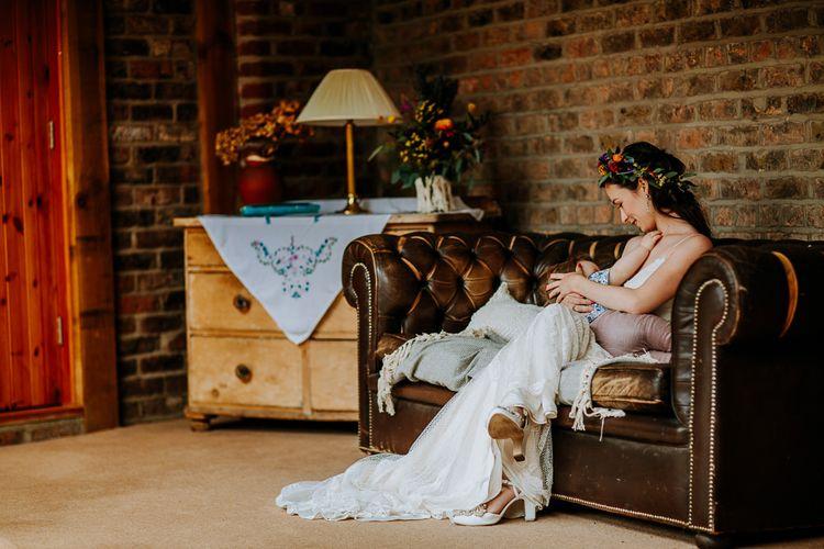 Bride in Lace Sottero & Midgley Wedding Dress Breast Feeding Her Infant