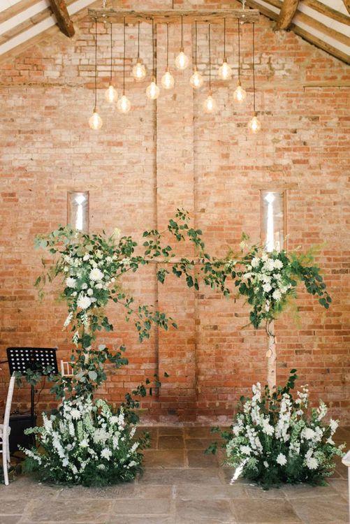 White wedding flowers for ceremony decor