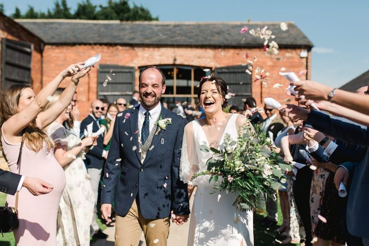 Confetti exit and white wedding flowers bouquet