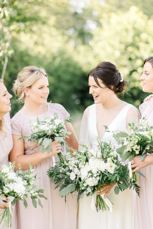 Bride and bridesmaids with white wedding flowers