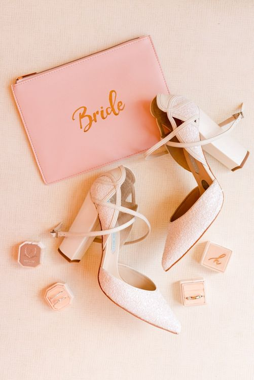 White wedding shoes with bride pouch