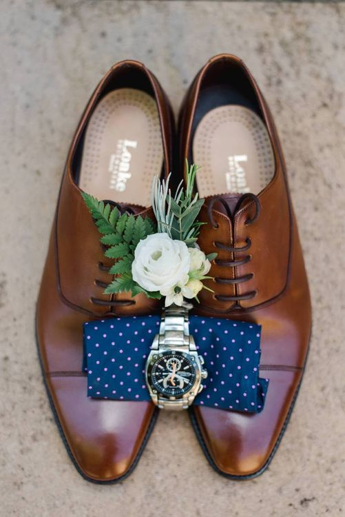Brown brogue shoes for groom with white wedding flowers buttonhole