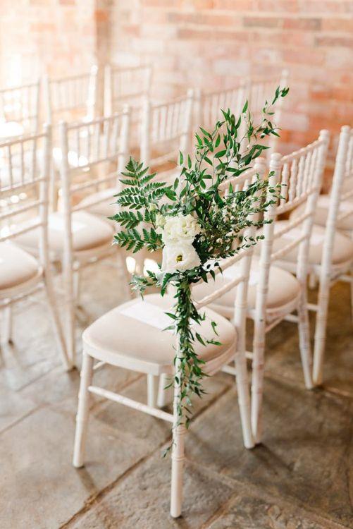 White wedding flowers chair back decor