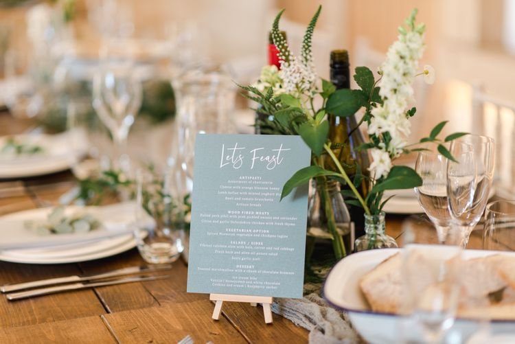 Wedding table stationery with white wedding flowers