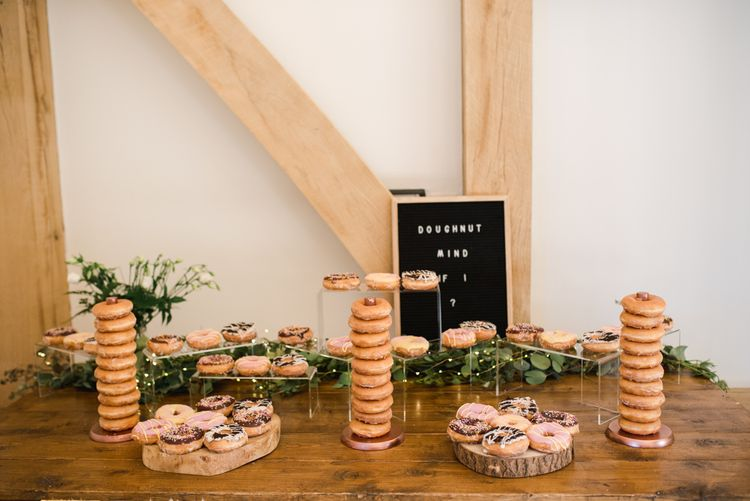 Doughnut table at wedding with peg board sign
