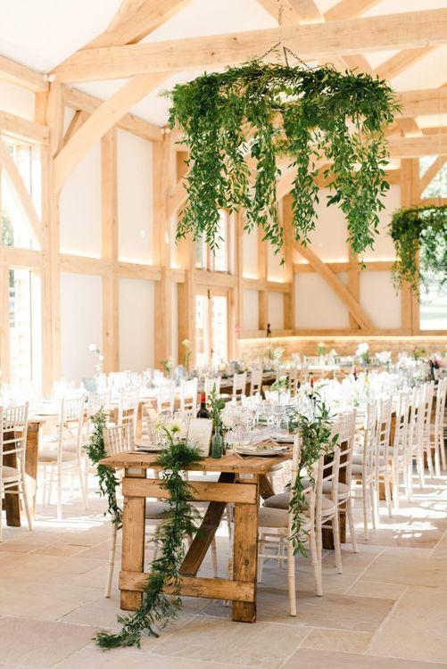 Foliage and white wedding flowers decor for wedding breakfast