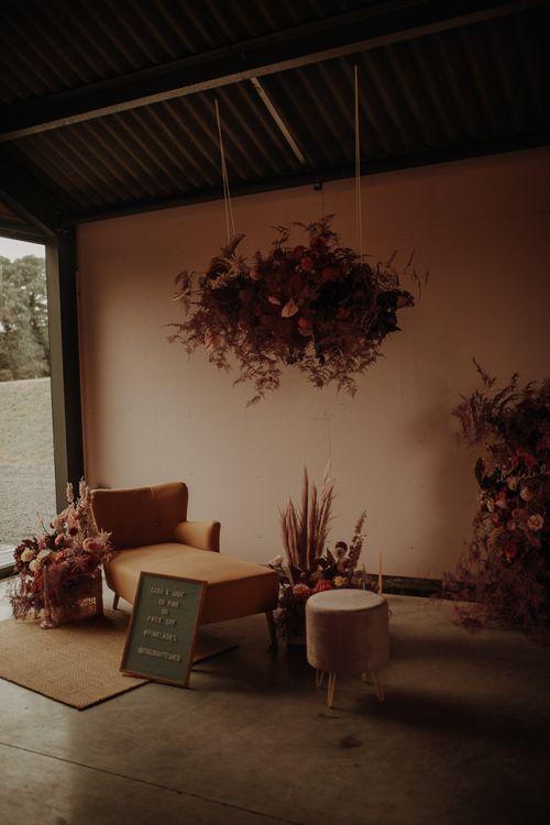 Relaxed seating area at The Giraffe Shed with flower installation