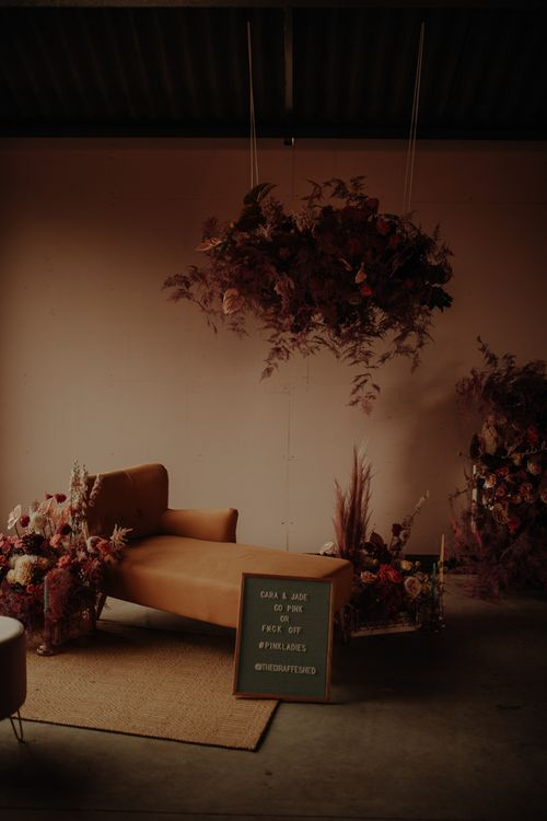 Floral installation and chaise seating area at The Giraffe Shed