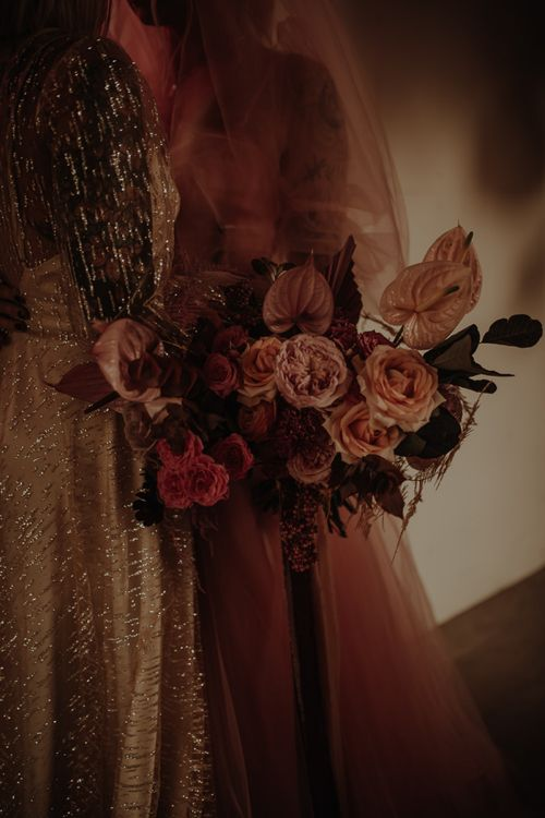 Pink wedding bouquet with roses and anthuriums